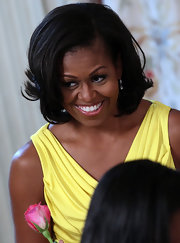 Michelle Obama sported a retro wavy hairstyle at the White House event honoring military mothers.