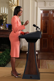 Michelle Obama wore a skirt suit in a lovely coral hue at the launch of Joining Forces.