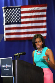 Michelle Obama looked exuberant in a turquoise tank top and a pink skirt while campaigning in Virginia.