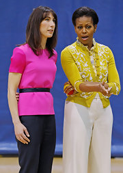 Michelle Obama wore a demure mustard cardigan with floral appliques when she attended an Olympic-themed chlidren's event.