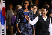 Michelle Obama visited Annandale High School looking seriously chic in a blue skirt suit.