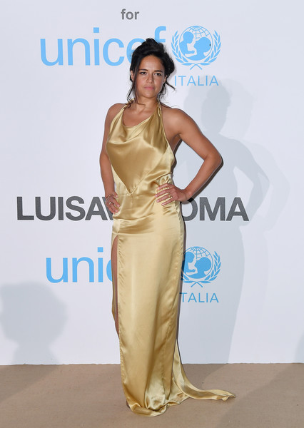 Michelle Rodriguez Halter Dress [dress,fashion model,clothing,shoulder,satin,fashion,carpet,red carpet,yellow,hairstyle,luisaviaroma,michelle rodriguez,photocall,luisaviaroma - photocall,italy,porto cervo,villa violina,unicef summer gala]