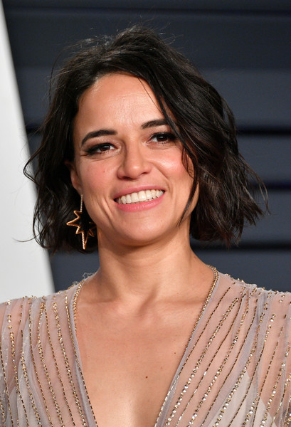 Michelle Rodriguez Bob [oscar party,vanity fair,hair,face,hairstyle,eyebrow,chin,lip,layered hair,shoulder,smile,long hair,california,beverly hills,wallis annenberg center for the performing arts,radhika jones - arrivals,radhika jones,michelle rodriguez]