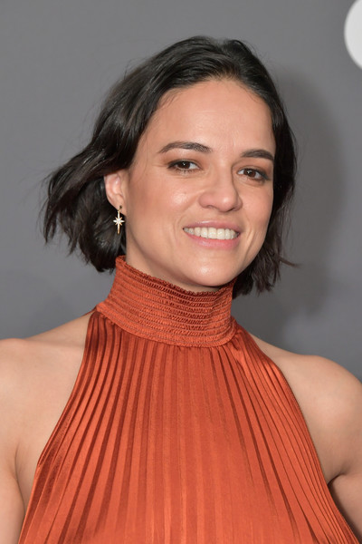 Michelle Rodriguez Short Wavy Cut [hair,neck,hairstyle,orange,beauty,chin,lip,shoulder,cheek,premiere,arrivals,michelle rodriguez,new york city,cipriani wall street,amfar new york]
