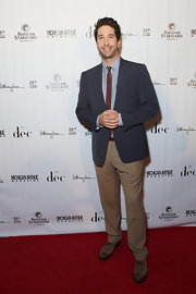 David chose a pair of tan slacks for his look while at the Michigan Avenue Magazine event.