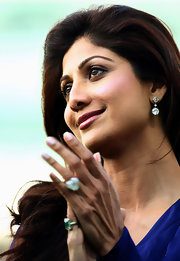 Shilpa Shetty attended the British Asian Challenge Match wearing a beautiful pair of dangling diamond earrings.