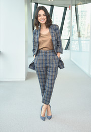 Mila Kunis teamed a Brunello Cucinelli plaid pantsuit with a gold shirt for the screening of 'The Spy Who Dumped Me.'