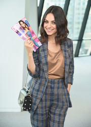 Mila Kunis attended the screening of 'The Spy Who Dumped Me' carrying a chic Jimmy Choo Lockett bag.