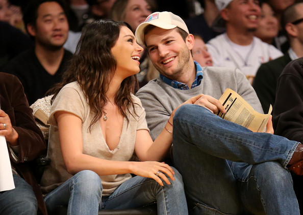 Mila Kunis V-Neck Tee [people,audience,youth,crowd,event,fun,sitting,jeans,student,smile,actors,ashton kucher,user,user,mila kunis,note,los angeles,oklahoma city thunder,los angeles lakers,game]