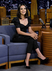 Mila Kunis visited 'Jimmy Fallon' wearing a Dolce & Gabbana pinstriped jumpsuit with puffed sleeves.
