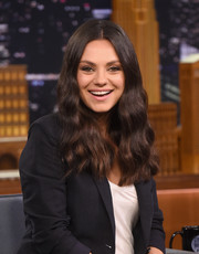 Mila Kunis styled her dark locks into a wavy center-parted 'do for her appearance on 'Jimmy Fallon.'