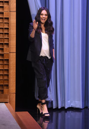 Mila Kunis pulled her look together with chic black ankle-wrap heels.