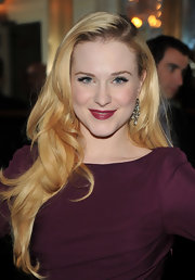 Evan Rachel Wood styled her long blond locks into soft curls that were swept over her shoulder.