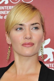 Kate Winslet wore a whisper of pink lipstick to the 'Mildred Pierce' photocall in Venice. Selecting lipstick just a shade darker than her natural lip color, with just a shine, kept her look natural.
