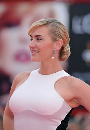 Kate Winslet's classic bun was the perfect complement to her daring dress at the 'Mildred Pierce' premiere in Venice.  Her hair swept back, twisted and secured at the nape and her bangs were swept to the side.