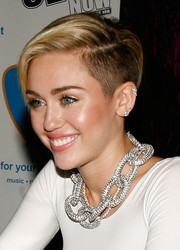 Miley Cyrus rocked a half-shaved 'do while promoting 'Bangerz' in New York City.