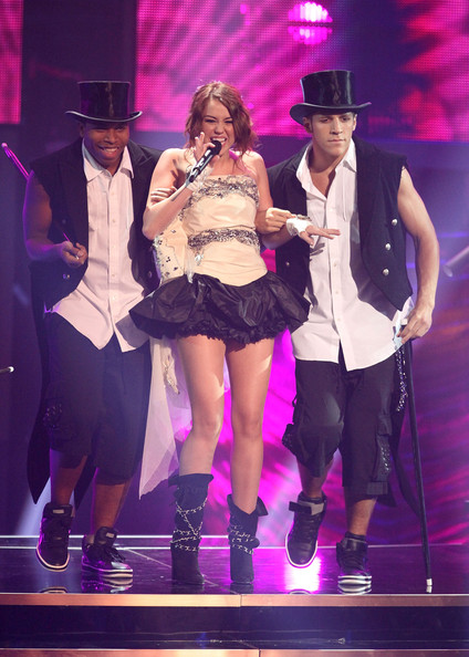 Miley Cyrus Mid-Calf Boots [performance,entertainment,performing arts,stage,music artist,event,public event,singing,thigh,concert,miley cyrus,vh1,new york city,brooklyn academy of music,divas - show,vh1 divas]