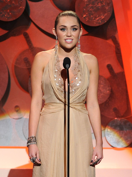 Miley Cyrus Gemstone Bracelet [chase - show,fashion,clothing,fashion show,fashion model,fashion design,public event,performance,event,peach,dress,miley cyrus,actress,american giving awards,california,los angeles,dorothy chandler pavilion]
