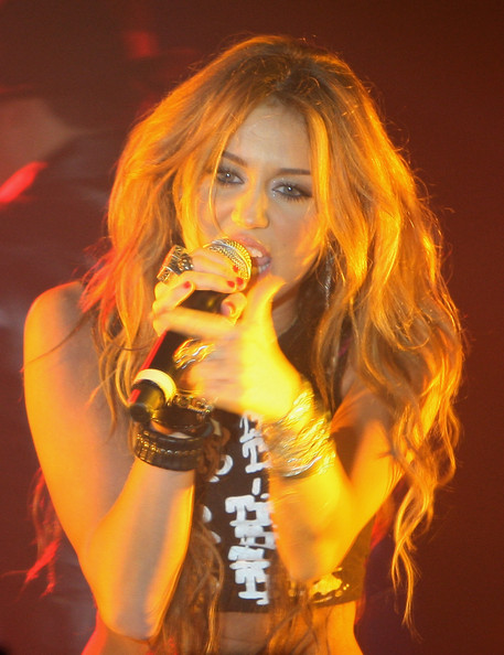 Miley Cyrus Leather Bracelet [hair,orange,music artist,beauty,yellow,lady,blond,performance,singing,hairstyle,miley cyrus,miley cyrus private concert,club,1515 club,paris,france]