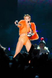 Miley Cyrus performed in Sao Paulo carrying a furry panda purse.