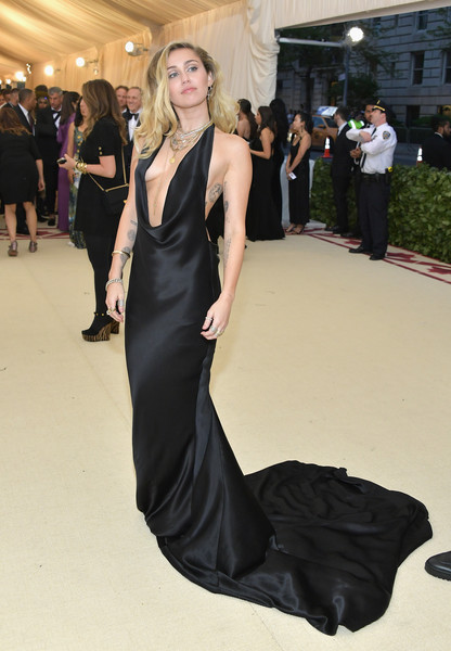 Miley Cyrus Halter Dress [heavenly bodies: fashion the catholic imagination costume institute gala - arrivals,clothing,dress,gown,fashion model,fashion,shoulder,red carpet,formal wear,carpet,hairstyle,new york city,metropolitan museum of art,miley cyrus]