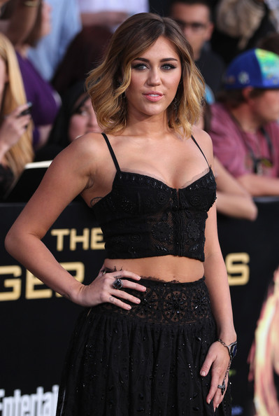 Miley Cyrus Diamond Ring [the hunger games,clothing,fashion model,long hair,fashion,hairstyle,blond,dress,brown hair,shoulder,abdomen,miley cyrus,los angeles,california,nokia theatre l.a. live,lionsgate,premiere,premiere]
