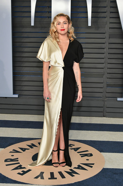 Miley Cyrus Strappy Sandals [oscar party,vanity fair,fashion model,fashion,flooring,dress,girl,catwalk,carpet,haute couture,fashion show,gown,beverly hills,california,wallis annenberg center for the performing arts,radhika jones - arrivals,radhika jones,miley cyrus]