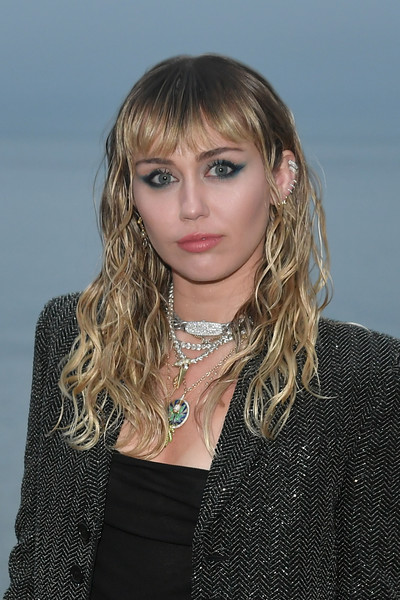 Miley Cyrus Long Curls with Bangs [hair,hairstyle,face,blond,eyebrow,beauty,layered hair,chin,long hair,bangs,miley cyrus,call,malibu,california,saint laurent mens spring summer 20 show]