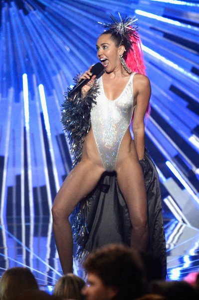 Miley Cyrus Evening Coat [performance,fashion model,beauty,dancer,lady,model,entertainment,competition,music artist,fashion show,phone,miley cyrus,mtv video music awards,california,los angeles,microsoft theater,samsung,show,miley cyrus,2015 mtv video music awards,microsoft theater,mtv video music award,video,mtv,music,mtv video music award for video of the year]