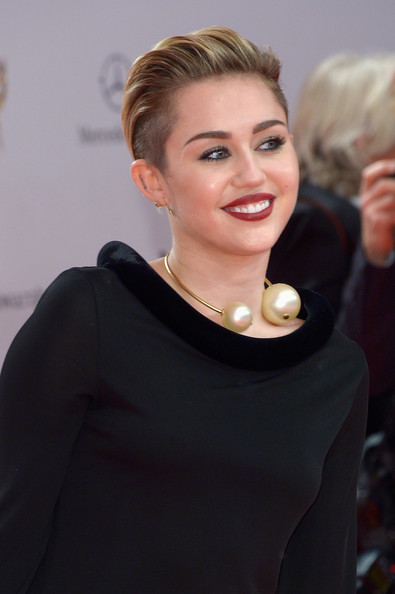 Miley Cyrus Faux Pearls [hair,face,blond,hairstyle,beauty,eyebrow,lip,chin,fashion,smile,miley cyrus,bambi awards,stage theater,berlin,germany,red carpet arrivals]