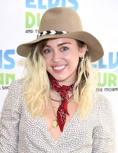 Miley Cyrus Gold Pendant [the elvis duran z100 morning show,fashion accessory,hat,headgear,blond,fedora,long hair,brown hair,cowboy hat,product,miley cyrus,coverage,new york city,z100 studio]
