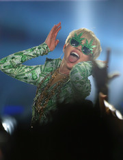 Miley Cyrus performed in London rocking a pair of weed leaf shades.