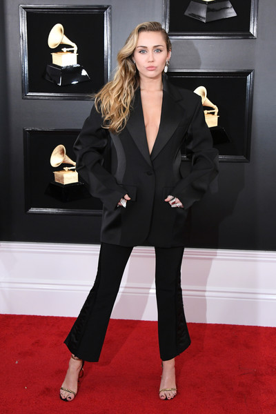 Miley Cyrus Pantsuit [red carpet,clothing,suit,carpet,formal wear,flooring,pantsuit,fashion,tuxedo,outerwear,arrivals,miley cyrus,grammy awards,staples center,los angeles,california,annual grammy awards]