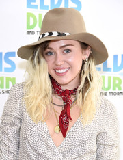 Miley Cyrus visited 'The Elvis Duran Z100 Morning Show' wearing a tan walker hat with black-and-white trim.