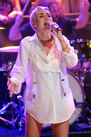 Miley Cyrus showed off her unique style with this white suspender bra layered over her shirt.