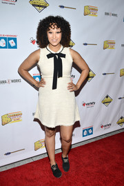 Tamera Mowry attended the Milk + Bookies Story Time celebration wearing a white Zara tweed mini dress with bow detail.