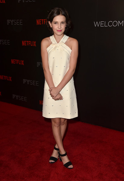 Millie Bobby Brown Evening Sandals [stranger things,fashion model,flooring,beauty,cocktail dress,lady,dress,shoulder,fashion,hairstyle,girl,arrivals,millie bobby brown,for your consideration,beverly hills,california,netflix,fyc,event,event,stranger things,netflix fysee,actor,netflix,eleven,celebrity]
