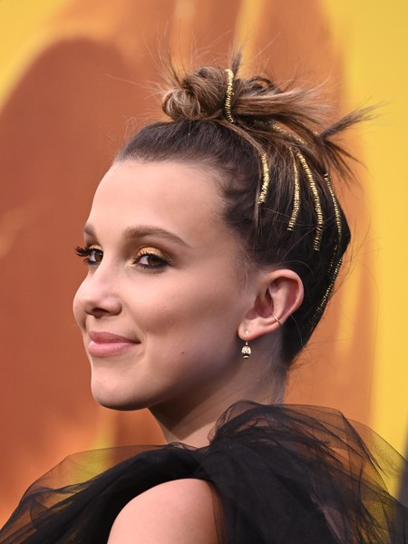 Millie Bobby Brown Hair Knot [warner bros. pictures and legendary pictures godzilla: king of the monsters,godzilla: king of the monsters,hair,face,hairstyle,eyebrow,chin,beauty,forehead,ear,long hair,chignon,arrivals,millie bobby brown,tcl chinese theatre,california,hollywood,premiere]