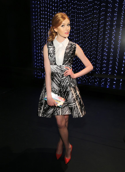Katherine McNamara completed her vibrant ensemble with a rainbow-striped box clutch.