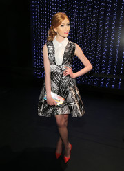 Katherine McNamara wore red pumps for a dash of color to her monochrome dress.