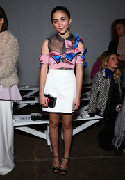 Rowan Blanchard showed off her mix-and-matching skills when she layered this bowed, color-block one-shoulder top over a sheer black blouse, both by Milly, when she attended the label's fashion show.