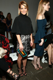 Candace Cameron Bure was all about easy sophistication in a black turtleneck with flutter sleeves during the Milly fashion show.