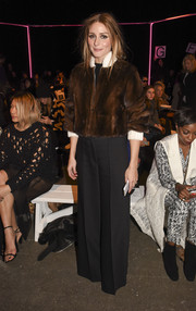 Olivia Palermo wore a tough-glam fur bomber jacket by Fendi to the Milly by Michelle Smith fashion show.
