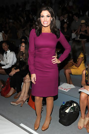 Kimberly Guilfoyle kept it modest yet stylish with a long-sleeve purple dress at the Milly by Michelle Smith fashion show.
