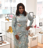 Mindy Kaling paired pink nail polish with a blue dress for her sweet pastel look during the celebration of her DSW partnership.