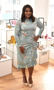 Mindy Kaling celebrated her DSW partnership wearing a sequined midi dress with long sleeves and a ruched skirt.