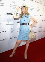 Kristin Meyer chose a denim shirt dress for the red carpet at the Minx by Eva Lutz fashion show.