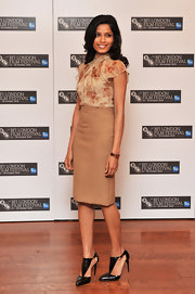 Freida Pinto showed off a pointed pair of black pumps, which she paired with a tan pencil skirt and floral blouse.