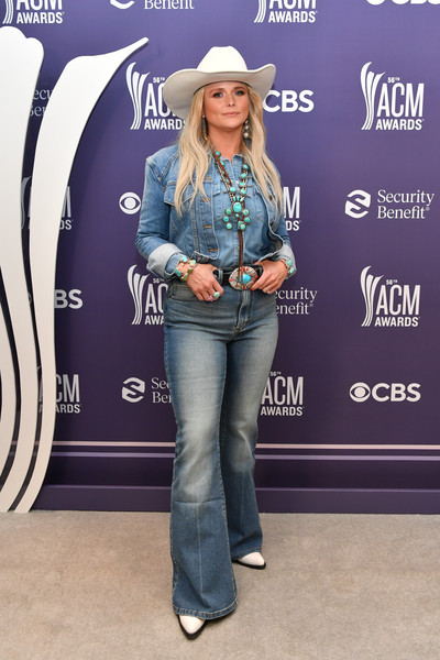 Miranda Lambert Flare Jeans [image,clothing,jeans,outerwear,hat,fashion,sleeve,street fashion,waist,luggage and bags,fedora,jeans,shoe,carpet,bikini top,miranda lambert,denim,fashion,backstage,academy of country music awards,jeans,fashion,shoe,carpet,denim,denim m,denim m,dos gardenias stein square neck bralette bikini top,product,celebrity]