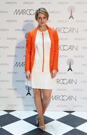 Mischa Barton rocked a mod-inspired, white drop-waist frock with a center orange stripe while at Fashion Week in Berlin.